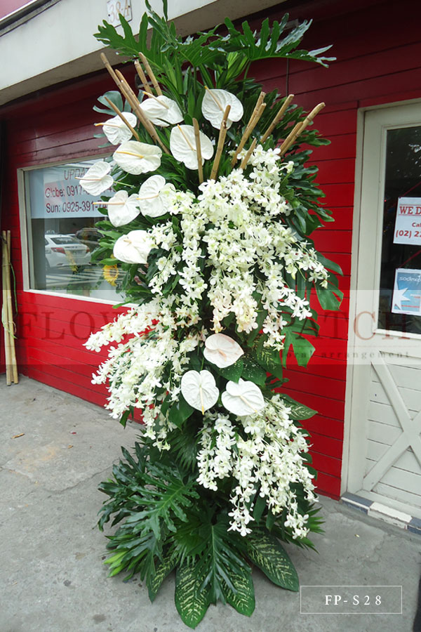 Standing Arrangement Of White Orchids And White Anthuriums Funeral Flowers